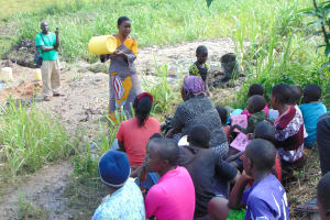 The Water Project: Bukhaywa Community, Shidero Spring -  Trainer Rose On Cleaning Water Jugs