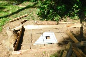 The Water Project: Emurumba Community, Makokha Spring -  Sanitation Slab Construction