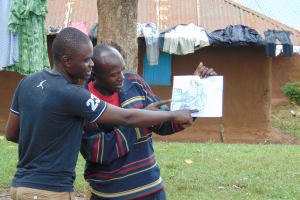 The Water Project: Imusutsu Community, Ikosangwa Spring -  Trainer Samuel And Participant Geoffrey Alulu