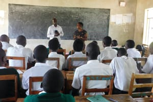 The Water Project: Sawawa Secondary School -  Sanitation Teacher Addresses Students