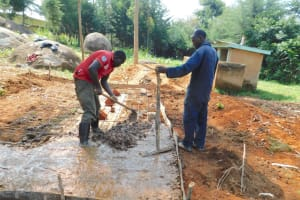 The Water Project: Hobunaka Primary School -  Pouring Concrete Latrine Foundation
