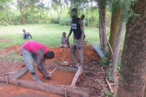The Water Project: Kalenda A Community, Webo Simali Spring -  Sanitation Slab Construction