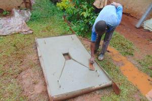 The Water Project: Kitulu Community, Kiduve Spring -  Finishing A Sanitation Slab
