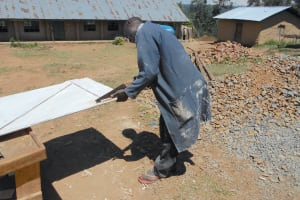 The Water Project: Bugute Lutheran Primary School -  Fitting Latrine Doors