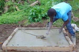 The Water Project: Mubinga Community, Mulutondo Spring -  Sanitation Slab Construction
