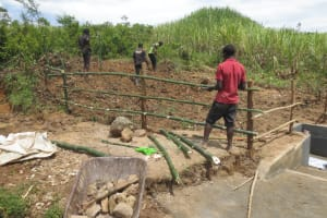 The Water Project: Tumaini Community, Ndombi Spring -  Fencing