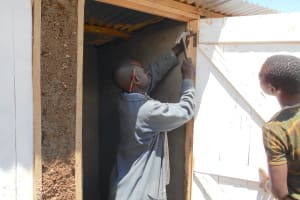 The Water Project: Bugute Lutheran Primary School -  Securing Latrine Doors