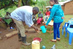 The Water Project: Musiachi Community, Mutuli Spring -  Man Demonstrates Handwashing