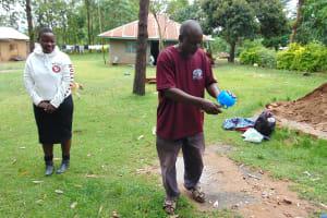 The Water Project: Mukangu Community, Metah Spring -  Mr Lusimba Demonstrates Toothbrushing