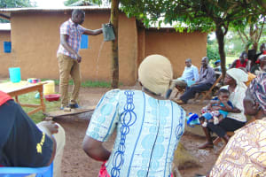 The Water Project: Musiachi Community, Mutuli Spring -  Leaky Tin Demonstration