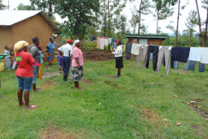 The Water Project: Mukangu Community, Metah Spring -  Discussing Importance Of Clotheslines