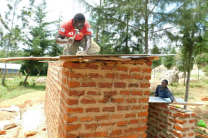The Water Project: Hobunaka Primary School -  Securing Latrine Roof