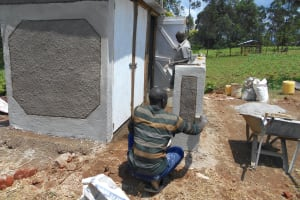 The Water Project: Bugute Lutheran Primary School -  Painting Latrines