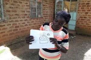 The Water Project: Mwichina Community, Matanyi Spring -  Participant Shows A Training Poster