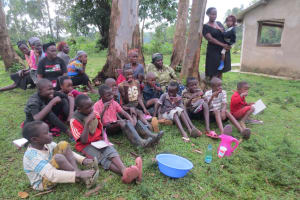 The Water Project: Rosterman Community, Lishenga Spring -  Mimicking Toothbrushing