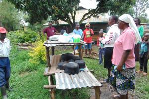 The Water Project: Mukangu Community, Metah Spring -  Discussing Importance Of Dishracks