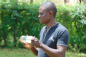 The Water Project: Imusutsu Community, Ikosangwa Spring -  Samuel Explains Solar Disinfection