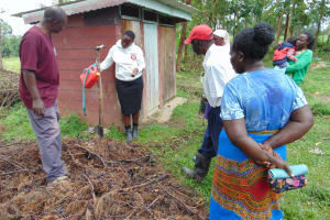 The Water Project: Mukangu Community, Metah Spring -  Looking At Example Of Improvised Leaky Tin