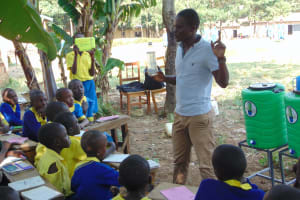 The Water Project:  Trainer Samuel Teaches Solar Disinfection