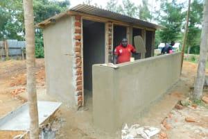 The Water Project: Hobunaka Primary School -  Plastering Latrine Wall