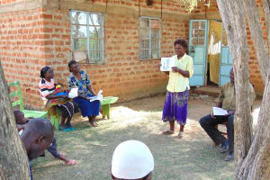 The Water Project: Mwichina Community, Matanyi Spring -  A Woman Leads A Discussion