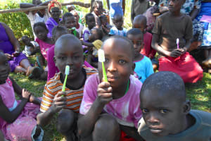The Water Project: Kalenda A Community, Webo Simali Spring -  Participants Show Off New Toothbrushes
