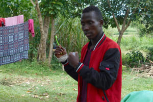 The Water Project: Kalenda B Community, Lumbasi Spring -  Trainer Ian On Dental Hygiene