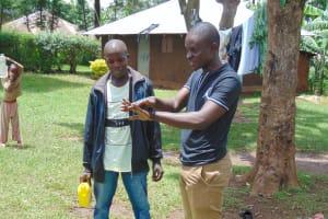 The Water Project: Imusutsu Community, Ikosangwa Spring -  Samuel Demonstrates Handwashing