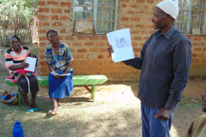 The Water Project: Mwichina Community, Matanyi Spring -  Man Leading Discussion