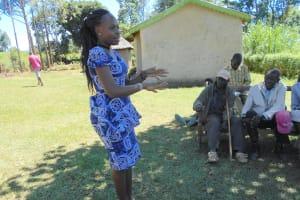 The Water Project: Kalenda A Community, Webo Simali Spring -  Trainer Patience On Handwashing