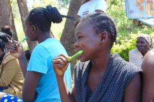 The Water Project: Mubinga Community, Mulutondo Spring -  Participants Imitate Toothbrushing