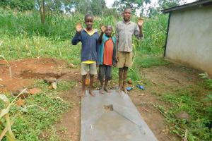 The Water Project: Rosterman Community, Lishenga Spring -  Kids Stand With Their Familiys New Sanitation Slab