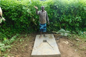 The Water Project: Rosterman Community, Lishenga Spring -  Standing Proud With New Sanitation Slab