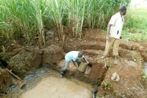 The Water Project: Namarambi Community, Iddi Spring -  Laying The Foundation