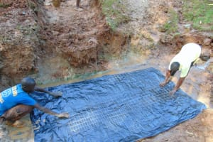 The Water Project: Kitulu Community, Kiduve Spring -  Foundation Laying