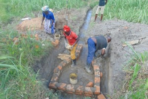 The Water Project: Bukhaywa Community, Shidero Spring -  Bricklaying With Community Help