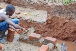 The Water Project: Imusutsu Community, Ikosangwa Spring -  Brick Setting