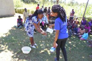 The Water Project: Kalenda A Community, Webo Simali Spring -  Trainers Demonstrate Handwashing