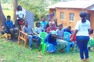 The Water Project: Mubinga Community, Mulutondo Spring -  Participants Listen To Trainer Laura
