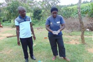 The Water Project: Emurumba Community, Makokha Spring -  Chv Grace Aswani Shows Handwashing