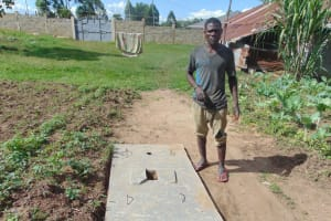 The Water Project: Mukangu Community, Metah Spring -  Owner Of New Sanitation Slab
