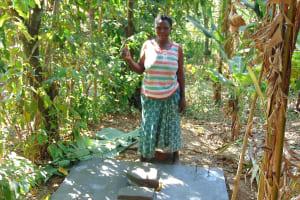 The Water Project: Mwichina Community, Matanyi Spring -  New Sanitation Slab Owner