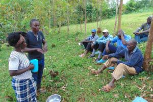 The Water Project: Kitulu Community, Kiduve Spring -  Samuel Leads Handwashing