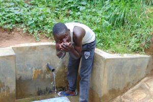 The Water Project: Mwichina Community, Matanyi Spring -  Enjoying A Fresh Drink