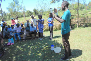 The Water Project: Kalenda A Community, Webo Simali Spring -  Trainer Amos On Solar Disinfection