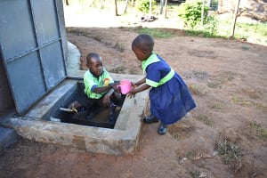 The Water Project: Khwihondwe SA Primary School -  Brother Helps Sister Get A Drink