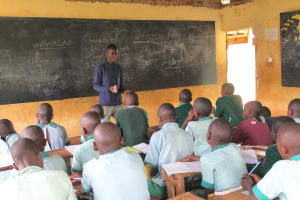 The Water Project: Bugute Lutheran Primary School -  Trainer Ian In Action