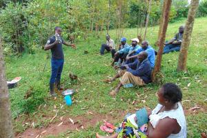 The Water Project: Kitulu Community, Kiduve Spring -  Samuel Explains Solar Disinfection