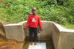 The Water Project: Mwichina Community, Matanyi Spring -  Moses Smiles At The Spring