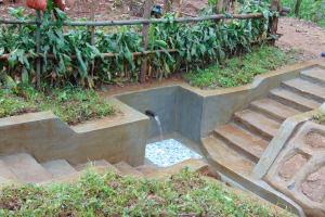 The Water Project: Imusutsu Community, Ikosangwa Spring -  Water Flows From Ikosangwa Spring